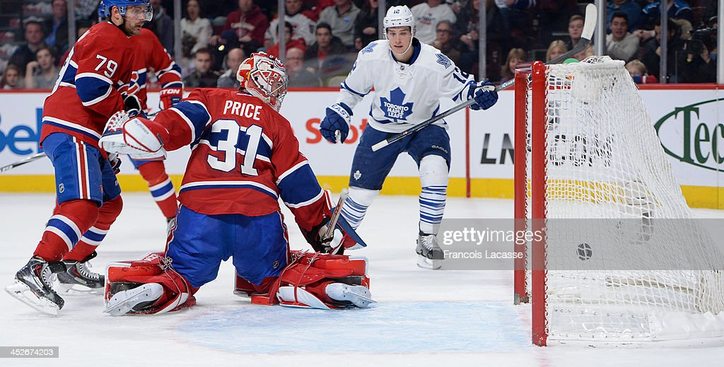 <a gi-track='captionPersonalityLinkClicked' href=/galleries/search?phrase=Mason+Raymond&family=editorial&specificpeople=4521385 ng-click='$event.stopPropagation()'>Mason Raymond</a> #12 of the Toronto Maple Leafs scores the second goal on <a gi-track='captionPersonalityLinkClicked' href=/galleries/search?phrase=Carey+Price&family=editorial&specificpeople=2222083 ng-click='$event.stopPropagation()'>Carey Price</a> #31 of the Montreal Canadiens while <a gi-track='captionPersonalityLinkClicked' href=/galleries/search?phrase=Andrei+Markov&family=editorial&specificpeople=204528 ng-click='$event.stopPropagation()'>Andrei Markov</a> #79 defends the goal during the NHL game on November 30, 2013 at the Bell Centre in Montreal, Quebec, Canada.