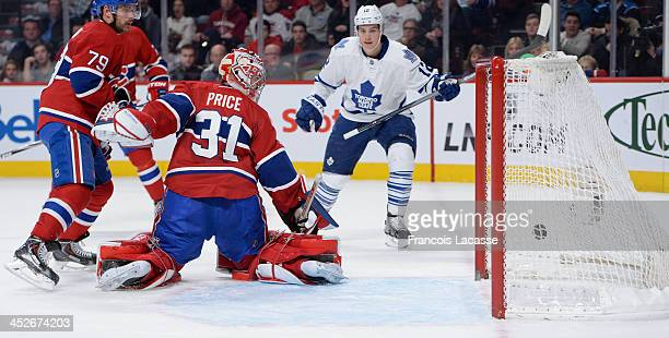 Mason Raymond of the Toronto Maple Leafs scores the second goal on Carey Price of the Montreal Canadiens while Andrei Markov defends the goal during...