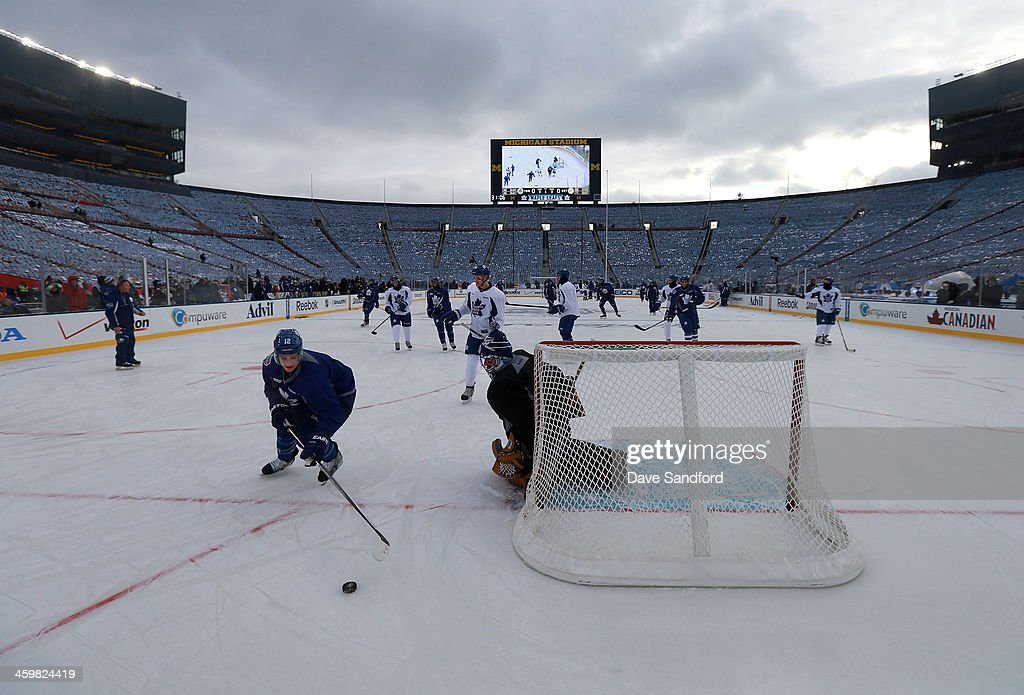 <a gi-track='captionPersonalityLinkClicked' href=/galleries/search?phrase=Mason+Raymond&family=editorial&specificpeople=4521385 ng-click='$event.stopPropagation()'>Mason Raymond</a> #12 of the Toronto Maple Leafs skates after the puck past goaltender <a gi-track='captionPersonalityLinkClicked' href=/galleries/search?phrase=Jonathan+Bernier&family=editorial&specificpeople=540491 ng-click='$event.stopPropagation()'>Jonathan Bernier</a> #45 during 2014 Bridgestone NHL Winter Classic team practice session on December 31, 2013 at Michigan Stadium in Ann Arbor, Michigan.