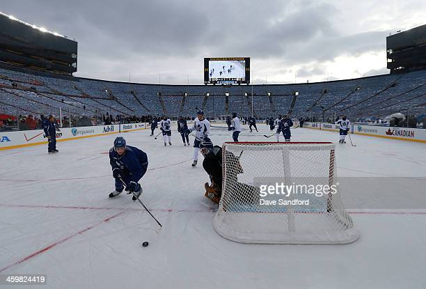 Mason Raymond of the Toronto Maple Leafs skates after the puck past goaltender Jonathan Bernier during 2014 Bridgestone NHL Winter Classic team...