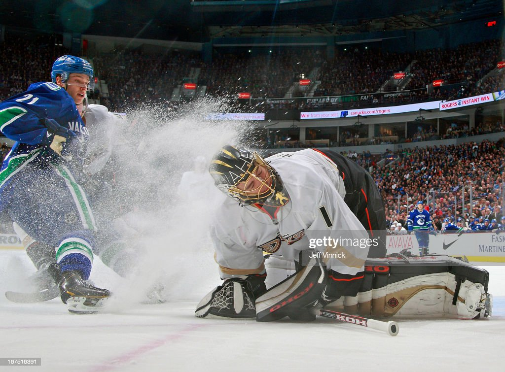 <a gi-track='captionPersonalityLinkClicked' href=/galleries/search?phrase=Mason+Raymond&family=editorial&specificpeople=4521385 ng-click='$event.stopPropagation()'>Mason Raymond</a> #21 of the Vancouver Canucks drew a penalty for spraying <a gi-track='captionPersonalityLinkClicked' href=/galleries/search?phrase=Jonas+Hiller&family=editorial&specificpeople=743364 ng-click='$event.stopPropagation()'>Jonas Hiller</a> #1 of the Anaheim Ducks during their NHL game at Rogers Arena April 25, 2013 in Vancouver, British Columbia, Canada. Anaheim won 3-1.