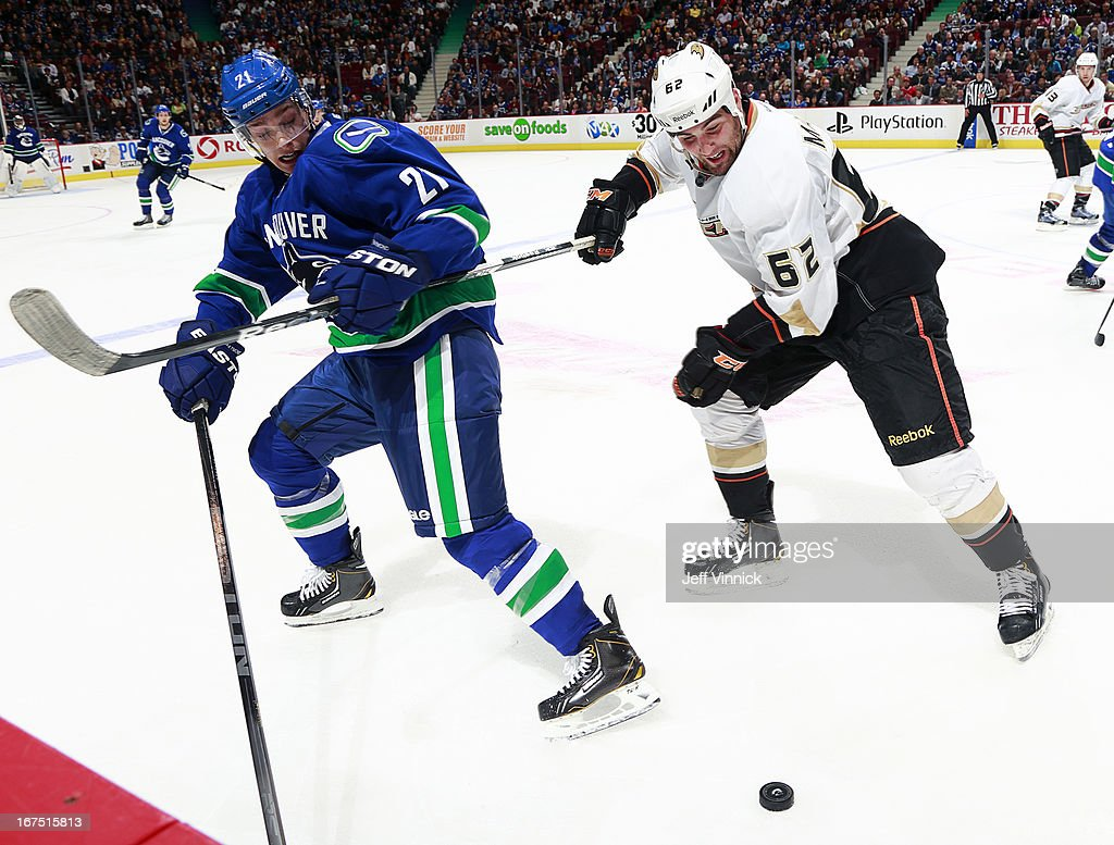 <a gi-track='captionPersonalityLinkClicked' href=/galleries/search?phrase=Mason+Raymond&family=editorial&specificpeople=4521385 ng-click='$event.stopPropagation()'>Mason Raymond</a> #21 of the Vancouver Canucks holds the stick of <a gi-track='captionPersonalityLinkClicked' href=/galleries/search?phrase=Patrick+Maroon&family=editorial&specificpeople=4589240 ng-click='$event.stopPropagation()'>Patrick Maroon</a> #62 of the Anaheim Ducks during their NHL game at Rogers Arena April 25, 2013 in Vancouver, British Columbia, Canada. Anaheim won 3-1.