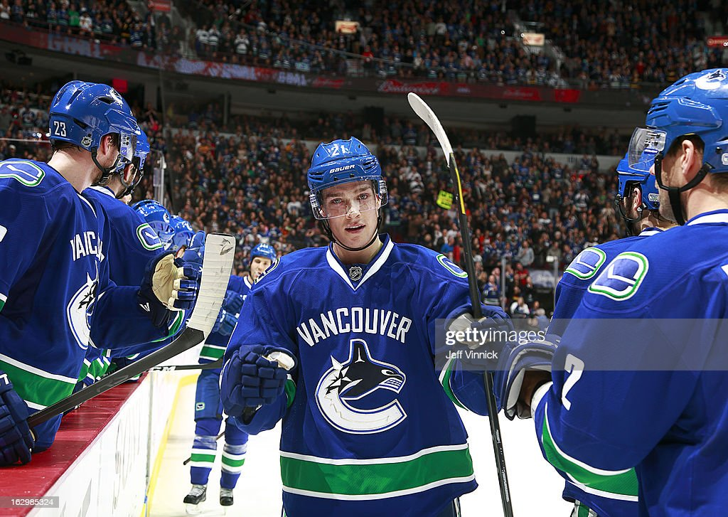 <a gi-track='captionPersonalityLinkClicked' href=/galleries/search?phrase=Mason+Raymond&family=editorial&specificpeople=4521385 ng-click='$event.stopPropagation()'>Mason Raymond</a> #21 of the Vancouver Canucks is congratulated at the bench after scoring against the Los Angeles Kings during their NHL game at Rogers Arena March 2, 2013 in Vancouver, British Columbia, Canada.