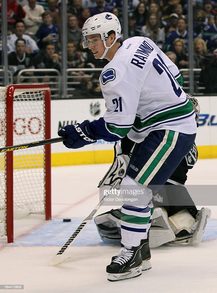 Mason Raymond #21 of the Vancouver Canucks looks on after scoring against goaltender Jonathan Quick #32 of the Los Angeles Kings in the first period during the NHL game at Staples Center on March 23, 2013 in Los Angeles, California. The Canucks defeated the Kings 1-0.