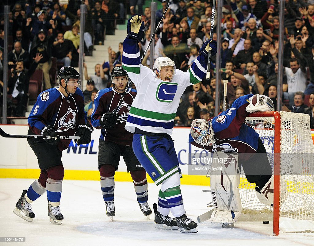 Mason Raymond #21 of the Vancouver Canucks scores the winning goal in over time at Rogers Arena on October 26, 2010 in Vancouver, British Columbia, Canada