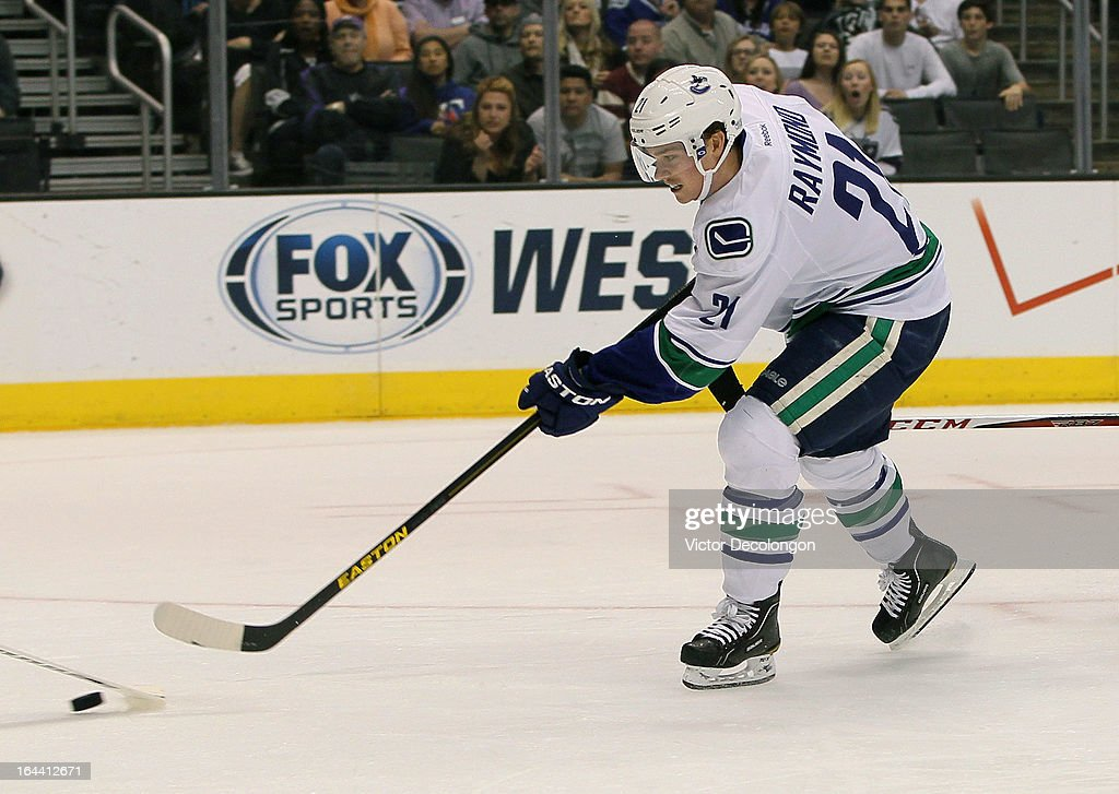 <a gi-track='captionPersonalityLinkClicked' href=/galleries/search?phrase=Mason+Raymond&family=editorial&specificpeople=4521385 ng-click='$event.stopPropagation()'>Mason Raymond</a> #21 of the Vancouver Canucks shoots the puck on his breakaway against goaltender Jonathan Quick #32 of the Los Angeles Kings (not in photo) in the first period during the NHL game at Staples Center on March 23, 2013 in Los Angeles, California. Raymond scored on the play. The Canucks defeated the Kings 1-0.