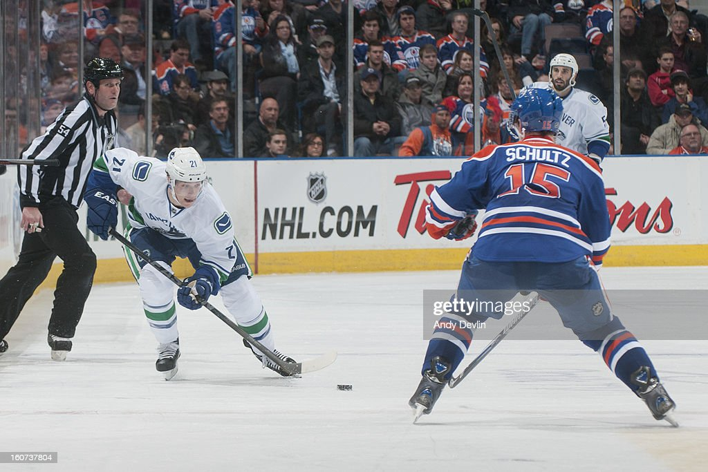 <a gi-track='captionPersonalityLinkClicked' href=/galleries/search?phrase=Mason+Raymond&family=editorial&specificpeople=4521385 ng-click='$event.stopPropagation()'>Mason Raymond</a> #21 of the Vancouver Canucks skates on the ice in an NHL game against the Edmonton Oilers on February 4, 2013 at Rexall Place in Edmonton, Alberta, Canada.