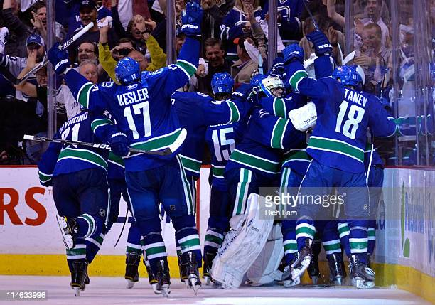 Mason Raymond Ryan Kesler Tanner Glass goaltender Roberto Luongo and Chris Tanev of the Vancouver Canucks and their teammates celebrate after they...