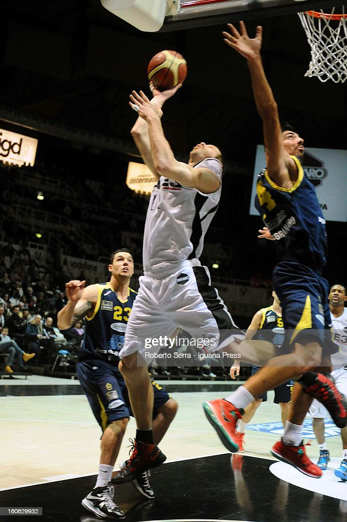 Mason Rocca of SAIE3 competes with Valerio Mazzola of Sutor during the LegaBasket Serie A match between Virtus Bologna SAIE3 and Sutor Montegranaro at Unipol Arena on February 3, 2013 in Bologna, Italy.