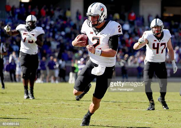 Mason Rudolph of the Oklahoma State Cowboys carries the ball to score a touchdown against the TCU Horned Frogs in the second half at Amon G Carter...