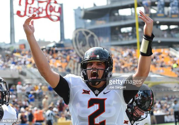 Mason Rudolph of the Oklahoma State Cowboys celebrates after a touchdown by Dillon Stoner during the first quarter against the Pittsburgh Panthers at...
