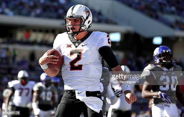 Mason Rudolph of the Oklahoma State Cowboys celebrates after scoring a touchdown against the TCU Horned Frogs in the second half at Amon G Carter...