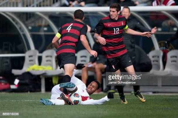 Mason Toye of Indiana University slides for the ball against Stanford University during the Division I Men's Soccer Championship held at Talen Energy...