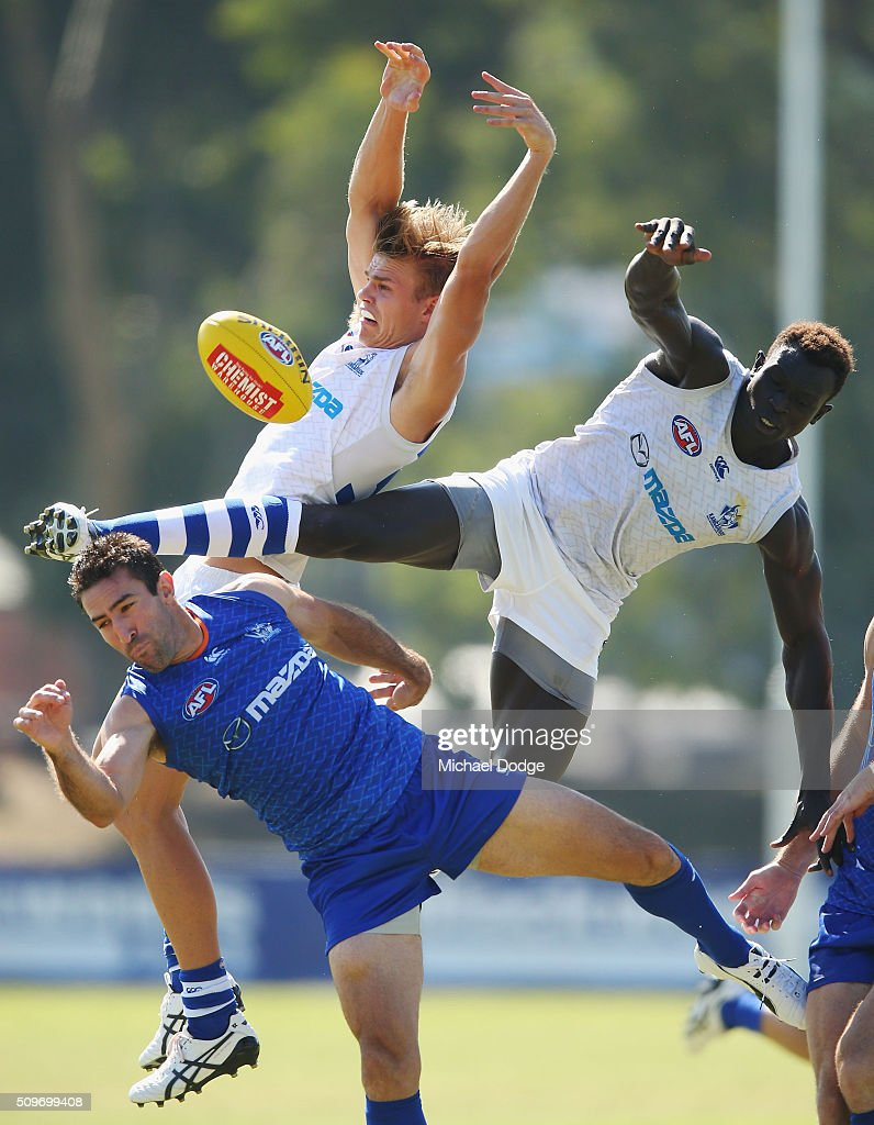 Mason Wood of the Kangaroos (L) and <a gi-track='captionPersonalityLinkClicked' href=/galleries/search?phrase=Majak+Daw&family=editorial&specificpeople=6756476 ng-click='$event.stopPropagation()'>Majak Daw</a> of the Kangaroos compete for the ball over <a gi-track='captionPersonalityLinkClicked' href=/galleries/search?phrase=Michael+Firrito&family=editorial&specificpeople=221362 ng-click='$event.stopPropagation()'>Michael Firrito</a> of the Kangaroos during the North Melbourne AFL Intra-Club match at Arden Street Ground on February 12, 2016 in Melbourne, Australia.
