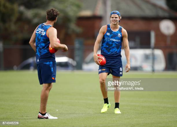 Mason Wood of the Kangaroos chats to Jarrad Waite of the Kangaroos during the North Melbourne Kangaroos training session at Arden St on November 15...