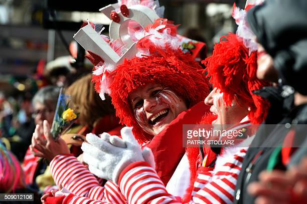 Masquaerade revellers celebrate the traditional Rose Monday carnival in Cologne western Germany on February 8 2016 / AFP / PATRIK STOLLARZ
