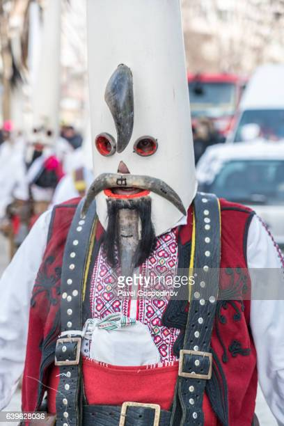 Masquerade Participant Wearing A Traditional Kukeri Costume And Masque During A Traditional Kukeri Festival