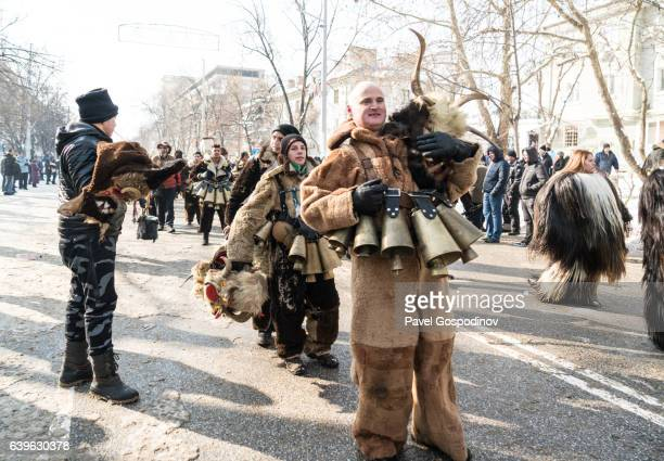 Masquerade Participants Marching In Procession During A Traditional Kukeri Festival