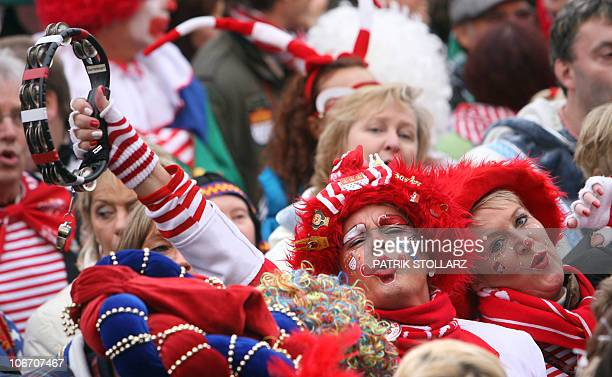 Masqueraded revellers celabrate the start of the carnival season in the western German city of Cologne on November 11 2010 Carnival goers mainly in...