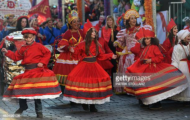 Masqueraded revellers celebrate the carnival at the traditional SchoolParade 'Schuul un Veedelzuch' in the western German city of Cologne on February...