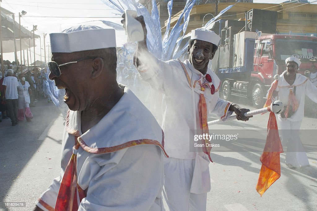 Masqueraders in the band Joy, The Final Chapter, perform at a judging point in Port of Spain, Trinidad on February 12, 2013.