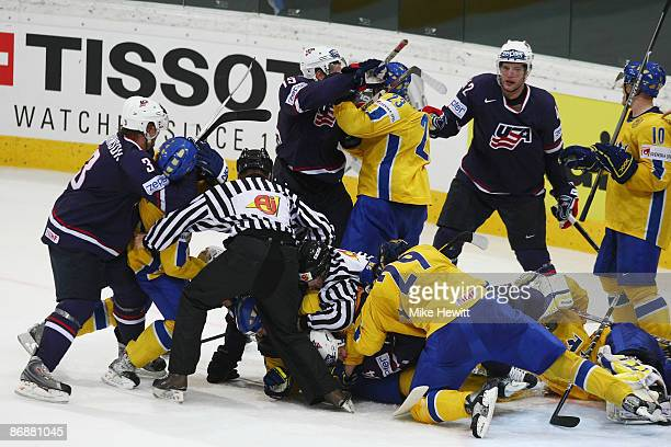 A mass brawl during the IIHF World Championship 3rd place play off between Sweden and USA at the PostFinance Arena on May 10 2009 in Bern Switzerland