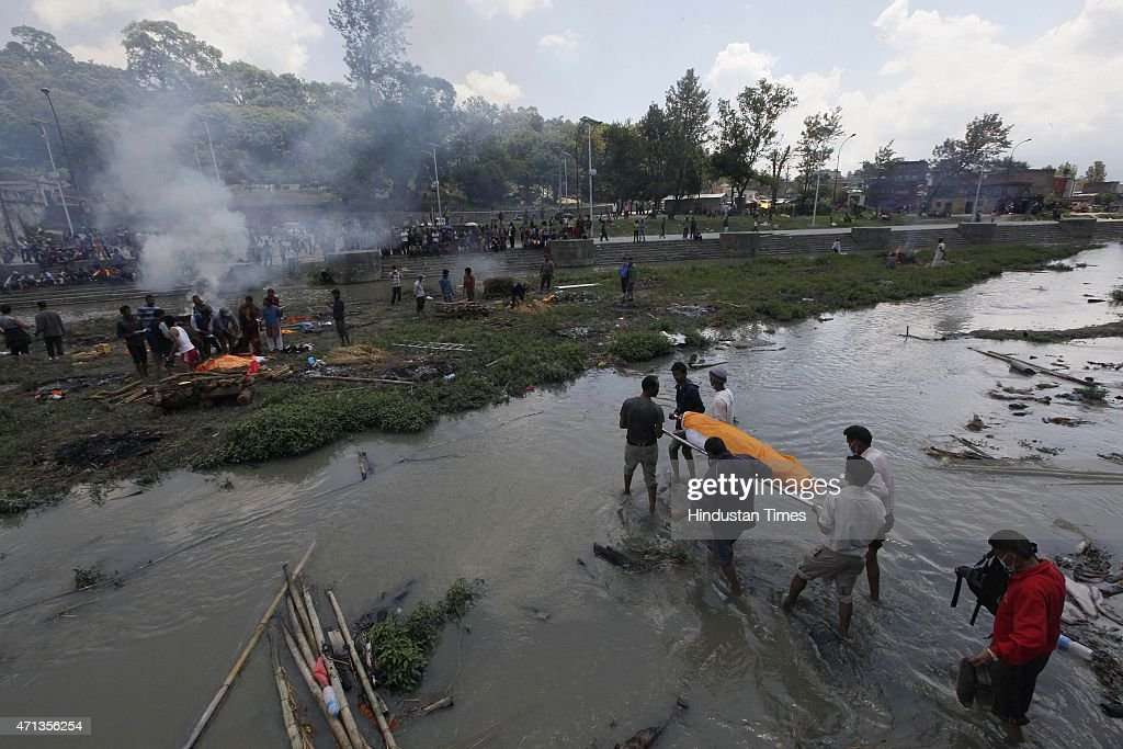 Mass cremations of earthquake victims at Pashupati Cremation Ghat Ground on April 27 2015 in Kathmandu Nepal A strong magnitude79 earthquake shook...