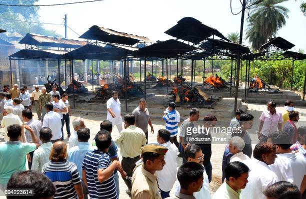Mass funeral of 24 illfated bus passengers who died in infamous bus truck collision conducted at City Cemetery Ground in presence of family members...