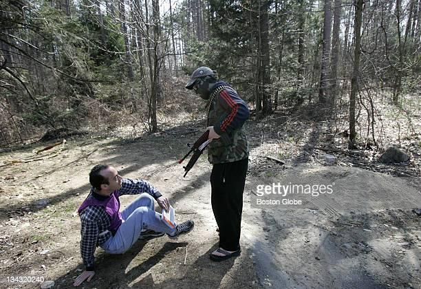 Mass General physician Peter Moschovis left is mockdetained by volunteer mockChad soldier Peter O'Connell as part of a humanitarian training...