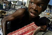Mass looting takes place in the PortauPrince Haiti as chaos spreads across the streets of the capital February 27 2004 in Porta Prince Haiti At least...
