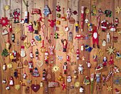 Mass of Christmas ornaments on wooden wool, front view