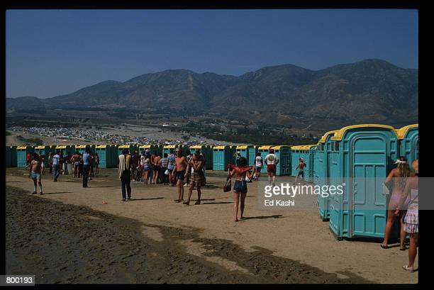 A mass of porta potties line the horizon as a crowd flocks to them at the Us festival September 7 1982 in Devore California The festival that drew...