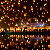 People release sky lanterns to pay homage to the triple gem: Budhha, Dharma and Sangha during Yi Peng festival.