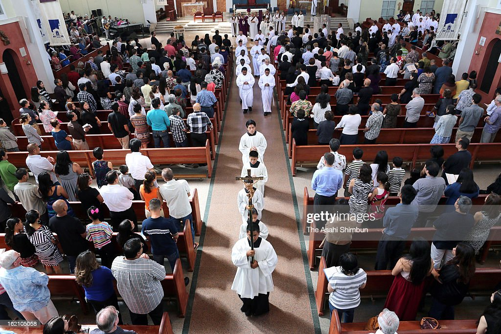 A mass to commemorate the victims of random stabbing takes place at the Dulce Nombre de Maria Cathedral-Basilica on February 17, 2013 in Guam, Guam. A 21-year-old man was arrested for killing three visitors and injuring a dozen others after crashing his car and stabbing people.
