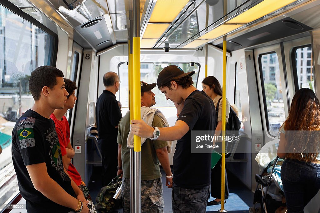Mass transit riders stand on a Miami-Dade county Metromover train on March 12, 2012 in Miami, Florida. With gas prices on the rise, mass transit systems around the country have seen a 2.31 percent rise in ridership during 2011 over the previous year according to the American Public Transportation Association.