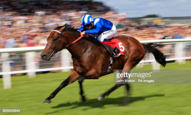 Massaat ridden by Jim Crowley on the way to winning The Betfred Hungerford Stakes at Newbury Racecourse