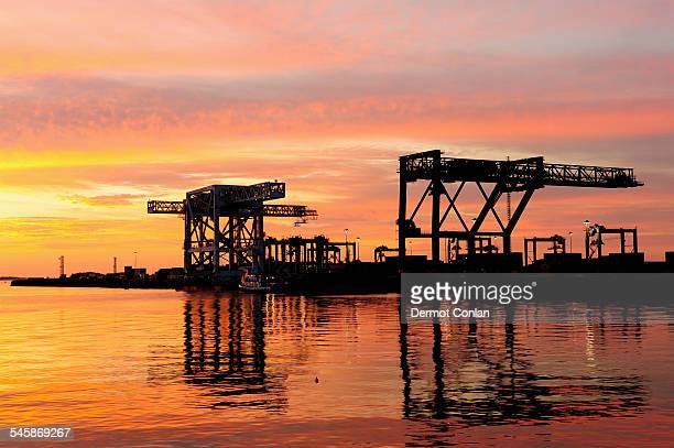 USA, Massachusetts, Boston, Colorful sky over Boston Harbor Dock