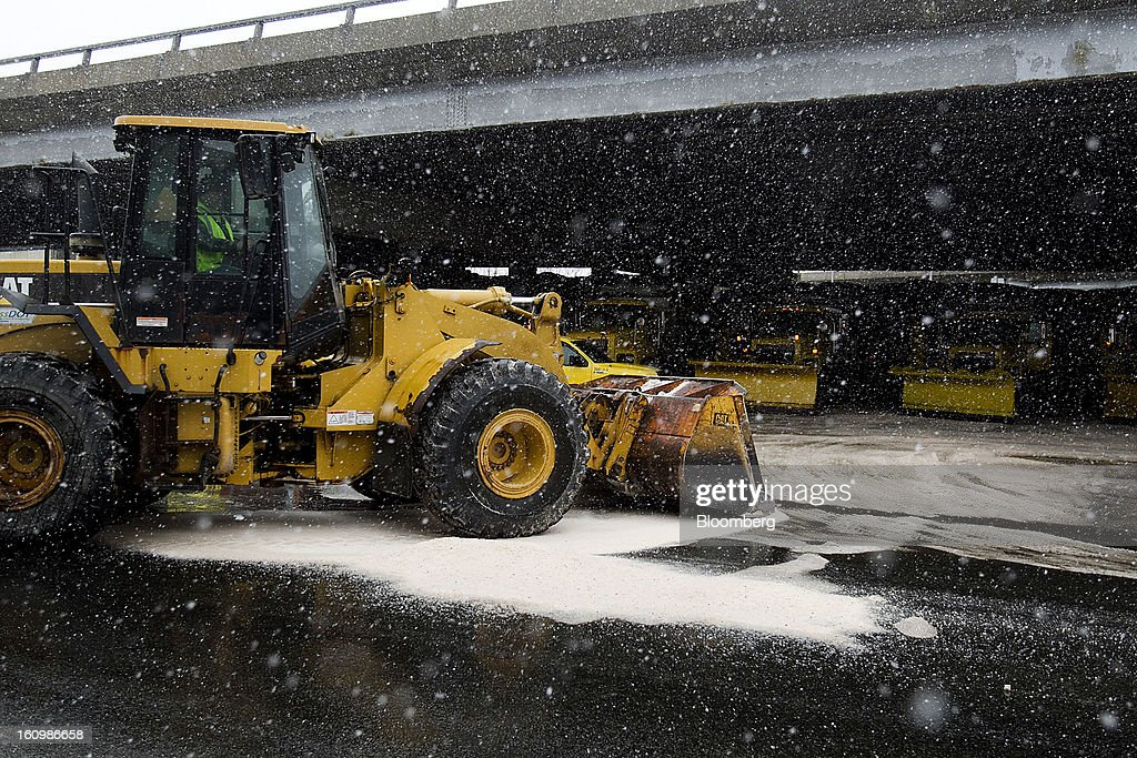 Massachusetts Deparment of Transportation (MassDOT) workers prepare snow plows at a salt depot under Interstate 93 in Somerville, Massachusetts, U.S., on Friday, Feb. 8, 2013. The New England cities are expected to receive more than 2 feet of snow by the time Winter Storm Nemo moves out tomorrow night, according to the weather service. Photographer: Kelvin Ma/Bloomberg via Getty Images