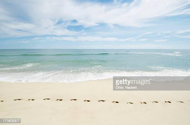 USA, Massachusetts, Footprints on empty beach