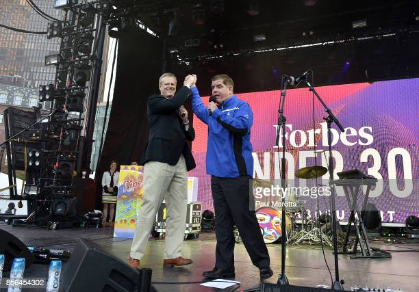 Massachusetts Governor Charlie Baker and Boston Mayor Marty Walsh attend at the Forbes Under 30 Music Festival at Boston City Hall Plaza on October 1...