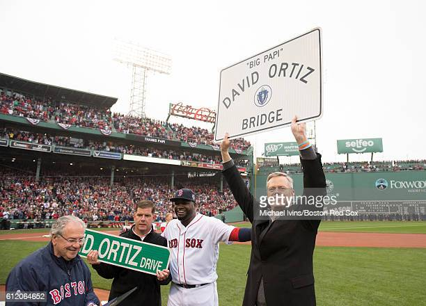 Massachusetts governor Charlie Baker holds up a sign to be put up on the Brookline Avenue bridge in honor of David Ortiz of the Boston Red Sox during...