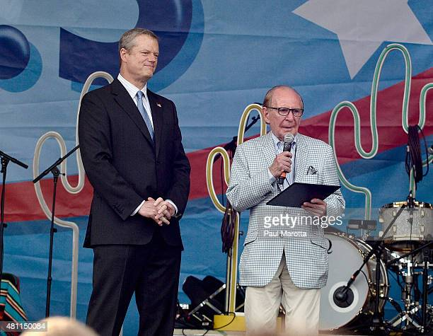 Massachusetts Governor Charlie Baker presents founder and philanthropist Ted Cutler with an award at the Outside the Box Festival Boston at Boston...