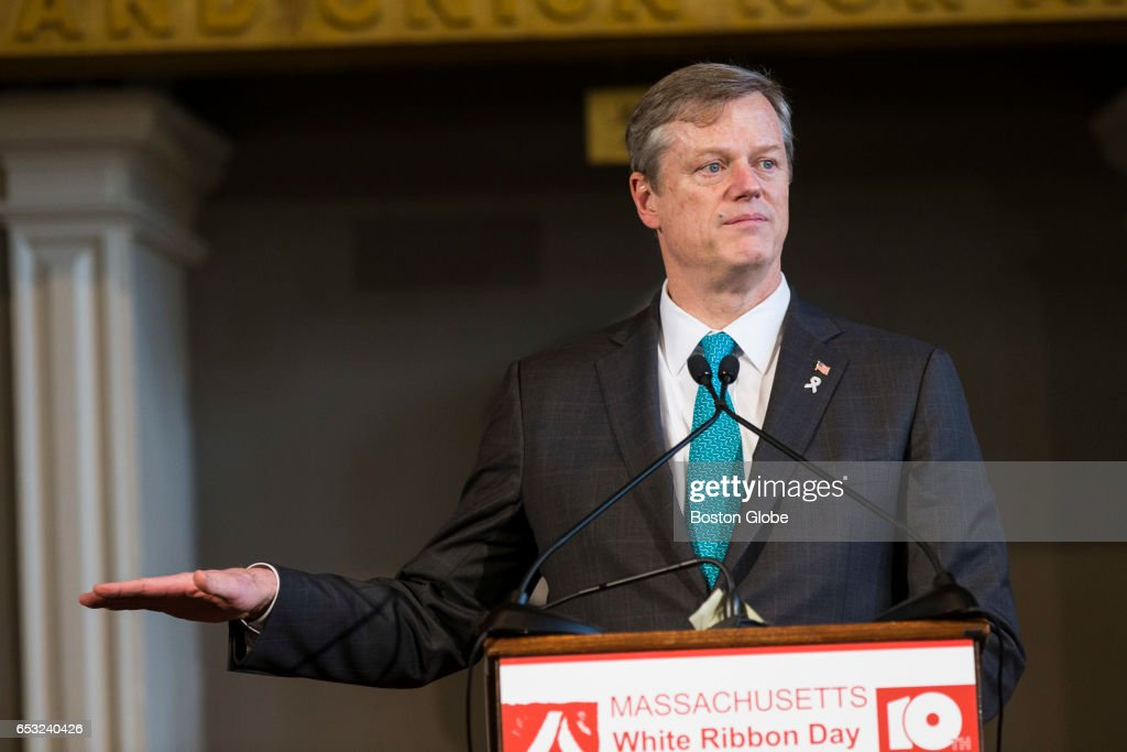 Massachusetts Governor Charlie Baker talks about meeting a victim of domestic violence as he takes part in the 10th Annual White Ribbon Day Campaign to promote solutions in ending violence against women and other gender-based violence at Faneuil Hall in Boston on Mar. 1, 2017.
