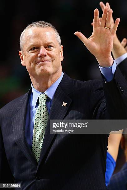 Massachusetts Governor Charlie Baker waves to the crowd during the second quarter of the game between the Boston Celtics and the New Orleans Pelicans...