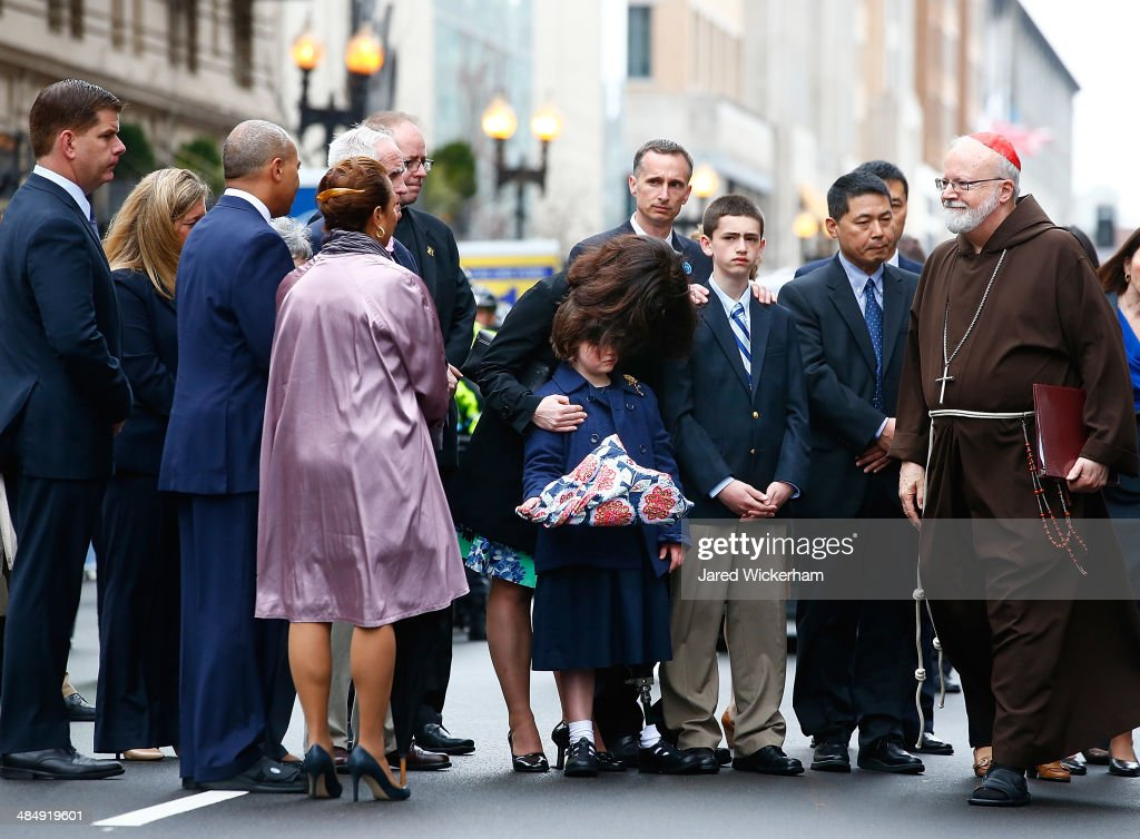 Massachusetts Governor Deval Patrick and Cardinal Sean Patrick O'Malley greet members of the victims families during a wreathlaying ceremony...