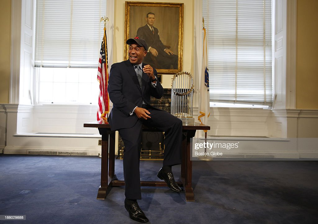 Massachusetts Governor Deval Patrick poses for a photo with the World Series trophy at the State House in Boston, Massachusetts on November 7, 2013.
