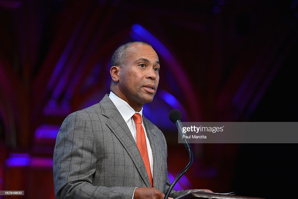 Massachusetts Governor <a gi-track='captionPersonalityLinkClicked' href=/galleries/search?phrase=Deval+Patrick&family=editorial&specificpeople=3980449 ng-click='$event.stopPropagation()'>Deval Patrick</a> presents the 2013 W.E.B. Du Bois Medal to Valerie Jarrett In Absentia at a ceremony at Harvard University's Sanders Theatre on October 2, 2013 in Cambridge, Massachusetts.