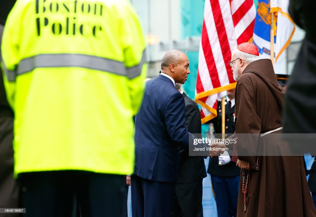 Massachusetts Governor <a gi-track='captionPersonalityLinkClicked' href=/galleries/search?phrase=Deval+Patrick&family=editorial&specificpeople=3980449 ng-click='$event.stopPropagation()'>Deval Patrick</a> shakes hands with Cardinal Sean Patrick O'Malley during a wreath-laying ceremony with members of the victims families commemorating the one-year anniversary of the Boston Marathon bombings on Boylston Street near the finish line on April 15, 2014 in Boston, Massachusetts. Last year, two pressure cooker bombs killed three and injured an estimated 264 others during the Boston marathon, on April 15, 2013.