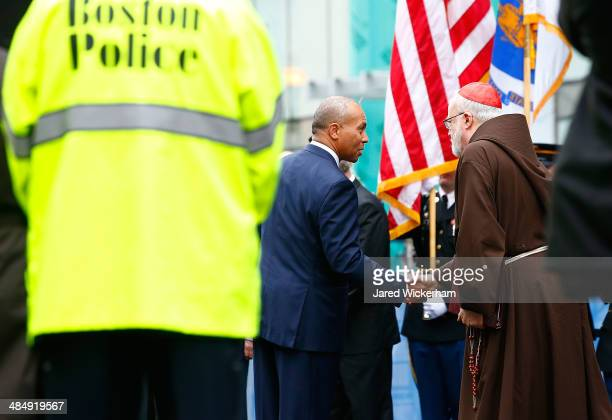 Massachusetts Governor Deval Patrick shakes hands with Cardinal Sean Patrick O'Malley during a wreathlaying ceremony with members of the victims...
