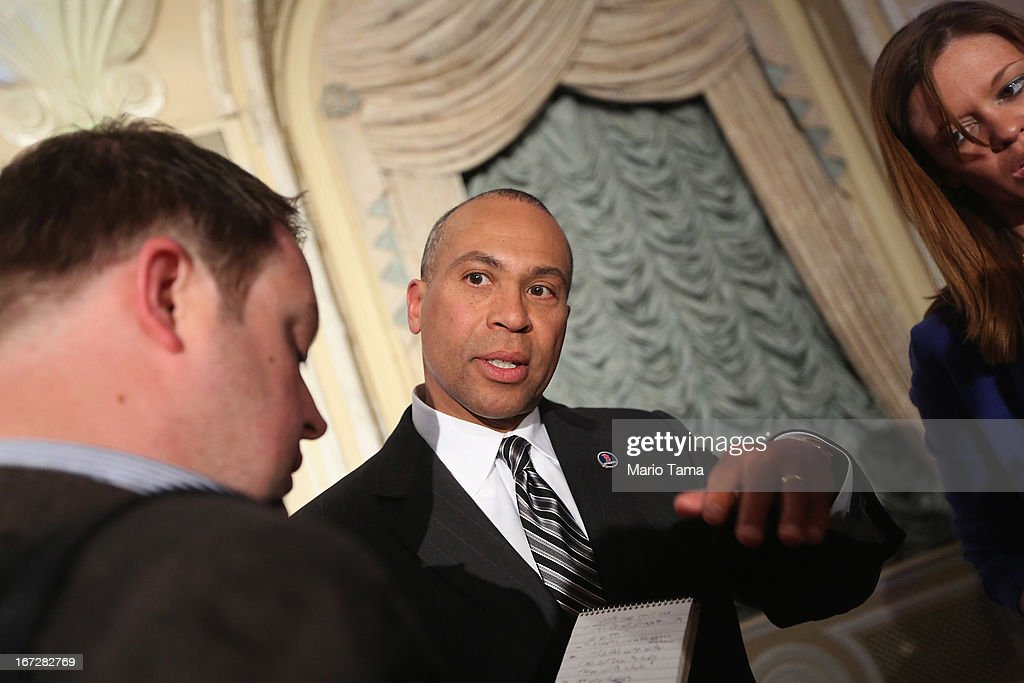 Massachusetts Governor Deval Patrick speaks toa reporter at a press conference heralding The One Fund on April 23 2013 in Boston Massachusetts...